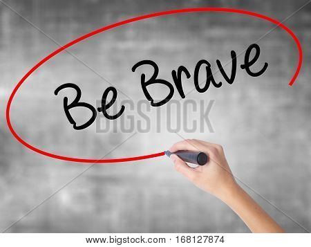 Woman Hand Writing Be Brave With Black Marker Over Transparent Board