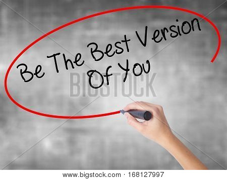 Woman Hand Writing Be The Best Version Of You With Black Marker Over Transparent Board