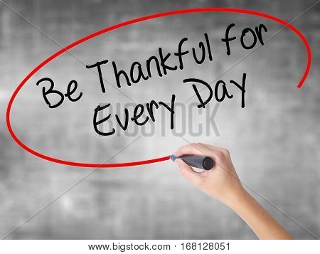 Woman Hand Writing Be Thankful For Every Day   With Black Marker Over Transparent Board