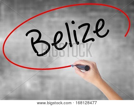 Woman Hand Writing Belize With Black Marker Over Transparent Board