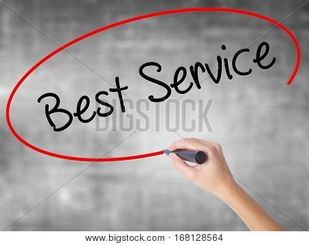 Woman Hand Writing Best Service With Black Marker Over Transparent Board