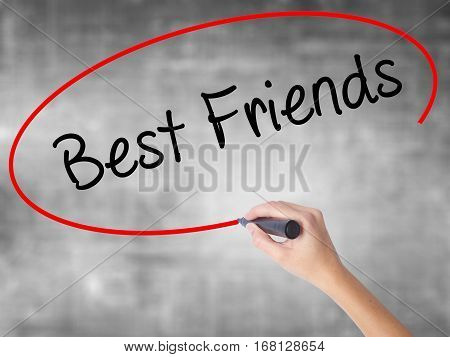 Woman Hand Writing Best Friends With Black Marker Over Transparent Board