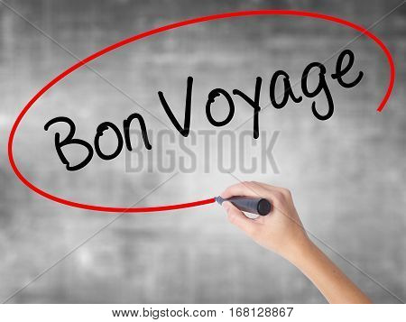 Woman Hand Writing  Bon Voyage  (have A Good Trip In French)  With Black Marker Over Transparent Boa