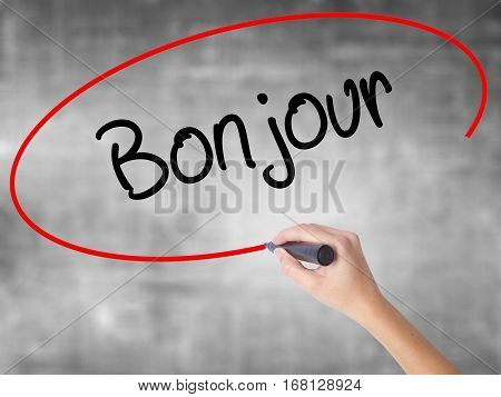 Woman Hand Writing Bonjour  (good Morning In French) With Black Marker Over Transparent Board