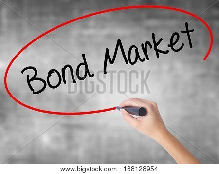 Woman Hand Writing Bond Market With Black Marker Over Transparent Board