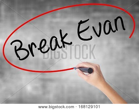 Woman Hand Writing Break Evan With Black Marker Over Transparent Board.
