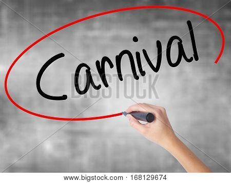 Woman Hand Writing Carnival With Black Marker Over Transparent Board