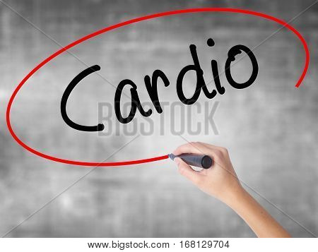 Woman Hand Writing Cardio With Black Marker Over Transparent Board