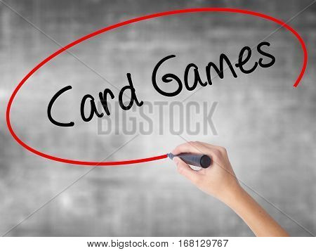 Woman Hand Writing Card Games With Black Marker Over Transparent Board