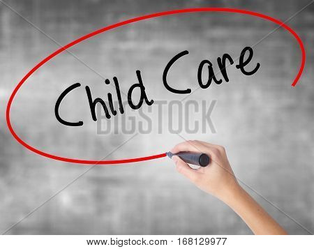 Woman Hand Writing Child Care With Black Marker Over Transparent Board