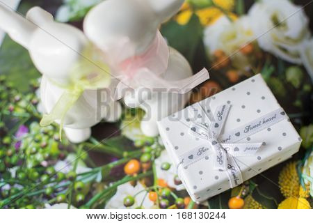 a gift box on the flower wooden background. St. Valentine's Day. kiss. February 14.
