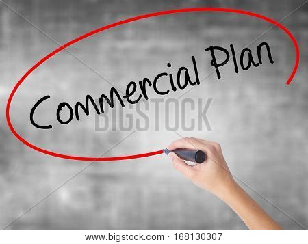 Woman Hand Writing Commercial Plan With Black Marker Over Transparent Board.