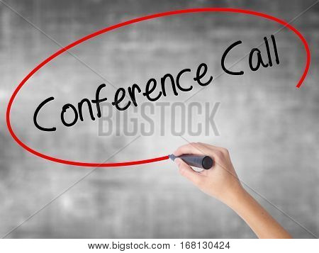 Woman Hand Writing Conference Call With Black Marker Over Transparent Board.