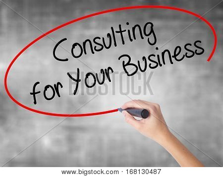 Woman Hand Writing Consulting For Your Business With Black Marker Over Transparent Board