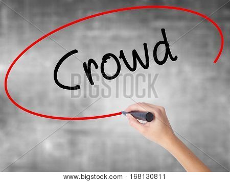 Woman Hand Writing Crowd With Black Marker Over Transparent Board