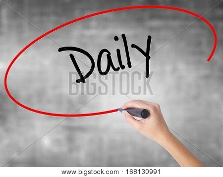 Woman Hand Writing Daily With Black Marker Over Transparent Board