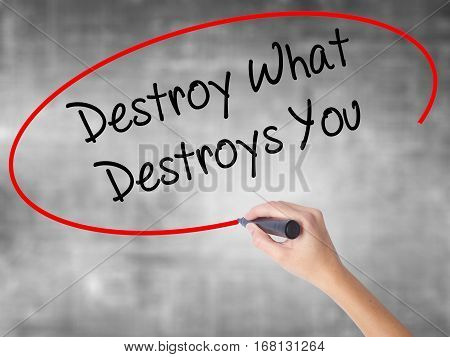 Woman Hand Writing Destroy What Destroys You With Black Marker Over Transparent Board.