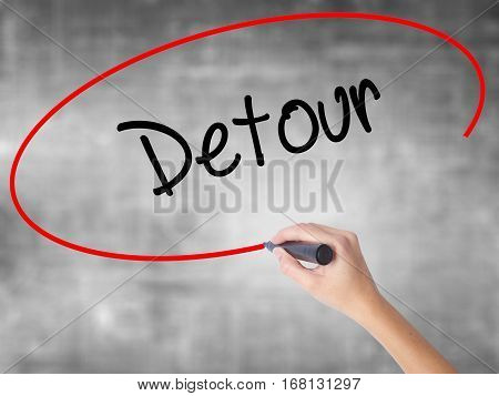 Woman Hand Writing Detour  With Black Marker Over Transparent Board