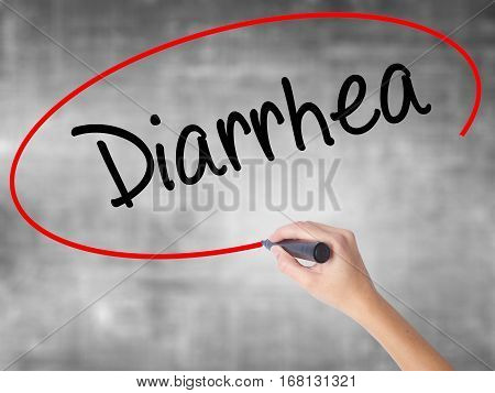 Woman Hand Writing  Diarrhea  With Black Marker Over Transparent Board