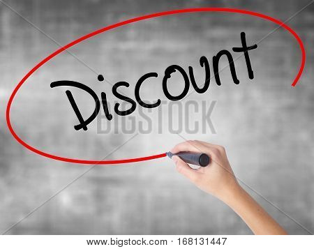 Woman Hand Writing Discount With Black Marker Over Transparent Board