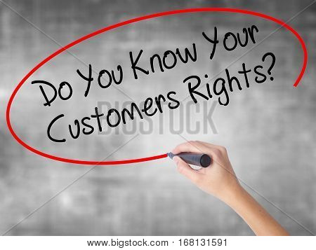 Woman Hand Writing Do You Know Your Customers Rights? With Black Marker Over Transparent Board.