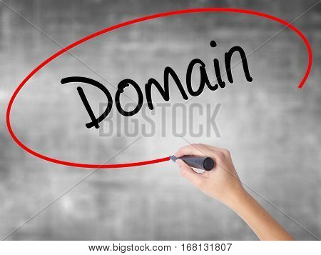 Woman Hand Writing Domain With Black Marker Over Transparent Board