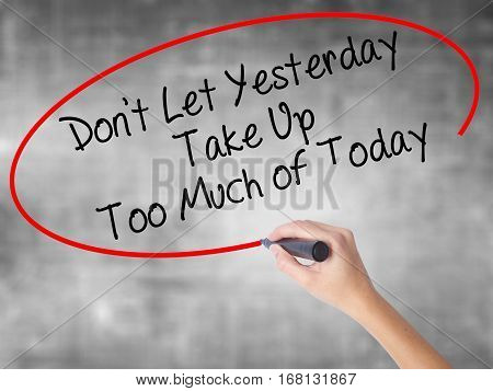 Woman Hand Writing Don't Let Yesterday Take Up Too Much Of Today With Black Marker Over Transparent