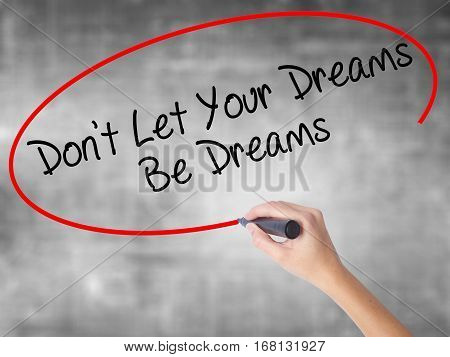 Woman Hand Writing Don't Let Your Dreams Be Dreams With Black Marker Over Transparent Board