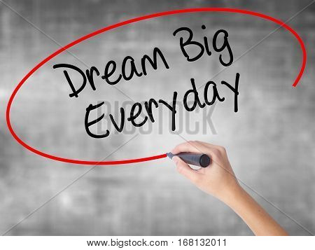 Woman Hand Writing Dream Big Everyday With Black Marker Over Transparent Board