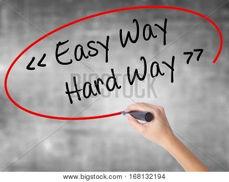 Woman Hand Writing Easy Way - Hard Way With Black Marker Over Transparent Board.