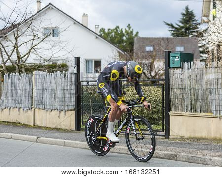 Conflans-Sainte-HonorineFrance-March 62016: The French cyclist Adrien Petit of Direct Energie Team riding during the prologue stage of Paris-Nice 2016.