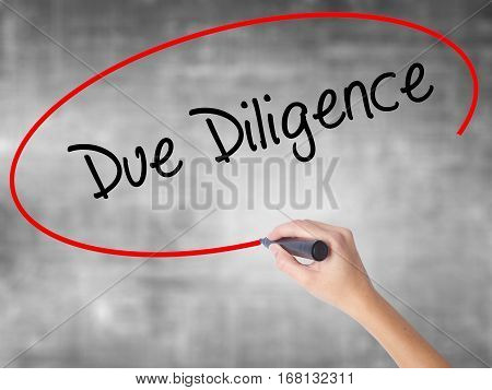 Woman Hand Writing Due Diligence With Black Marker Over Transparent Board
