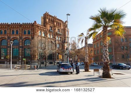 Barcelona Spain - January 04 2017: Cops patrol on the Plaza d'Andre Malraux in Barcelona at sunny day