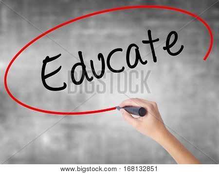 Woman Hand Writing Educate With Black Marker Over Transparent Board