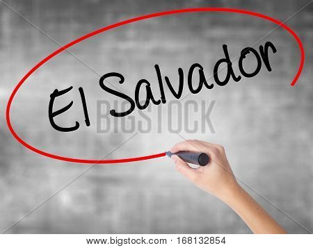 Woman Hand Writing El Salvador With Black Marker Over Transparent Board