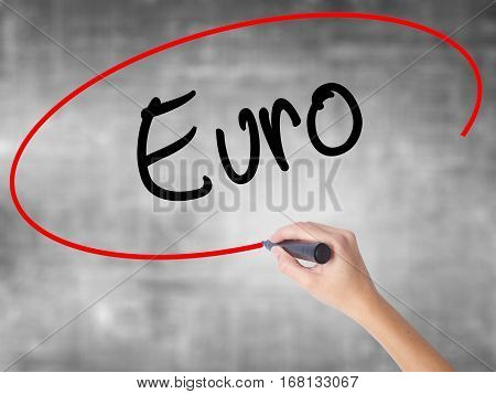 Woman Hand Writing Euro With Black Marker Over Transparent Board