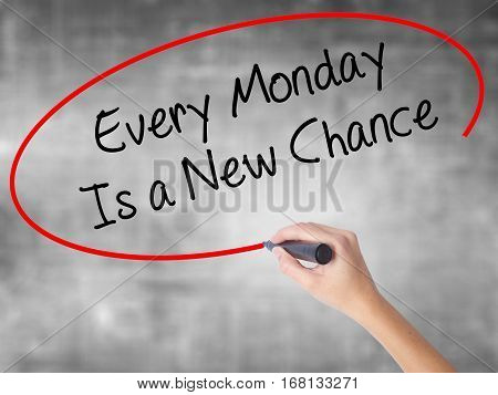 Woman Hand Writing Every Monday Is A New Chance With Black Marker Over Transparent Board