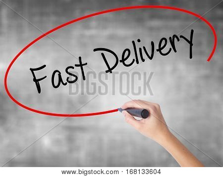 Woman Hand Writing  Fast Delivery With Black Marker Over Transparent Board