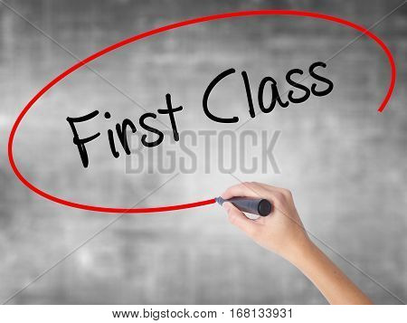 Woman Hand Writing First Class With Black Marker Over Transparent Board
