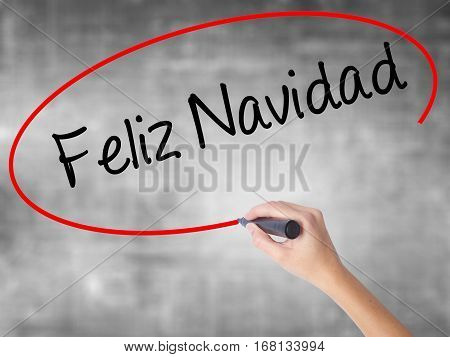 Woman Hand Writing Feliz Navidad  (merry Christmas In Spanish) With Black Marker Over Transparent Bo