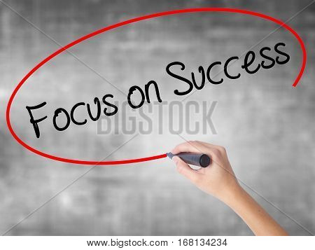 Woman Hand Writing Focus On Success With Black Marker Over Transparent Board