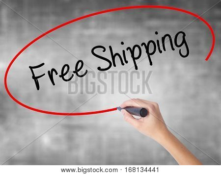 Woman Hand Writing Free Shipping With Black Marker Over Transparent Board