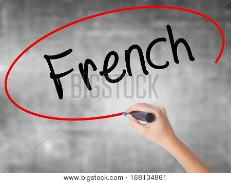 Woman Hand Writing French With Black Marker Over Transparent Board
