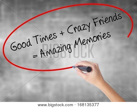 Woman Hand Writing Good Times + Crazy Friends = Amazing Memories With Black Marker Over Transparent