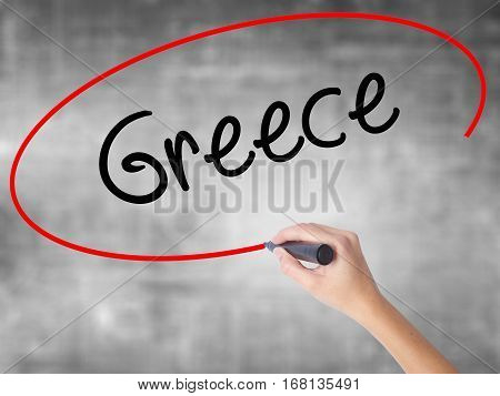 Woman Hand Writing Greece  With Black Marker Over Transparent Board