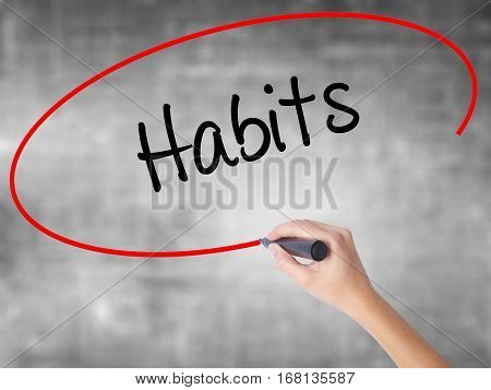 Woman Hand Writing Habits  With Black Marker Over Transparent Board