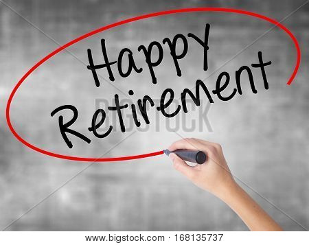 Woman Hand Writing Happy Retirement  With Black Marker Over Transparent Board