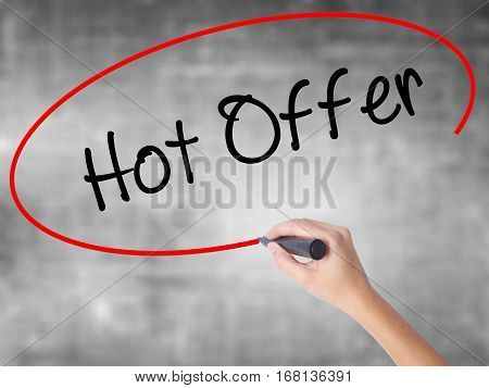 Woman Hand Writing Hot Offer With Black Marker Over Transparent Board.