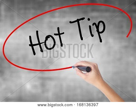 Woman Hand Writing Hot Tip With Black Marker Over Transparent Board.