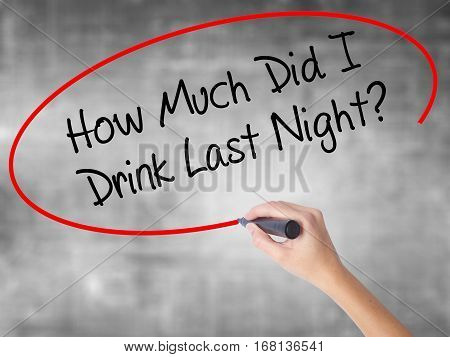 Woman Hand Writing How Much Did I Drink Last Night? With Black Marker Over Transparent Board